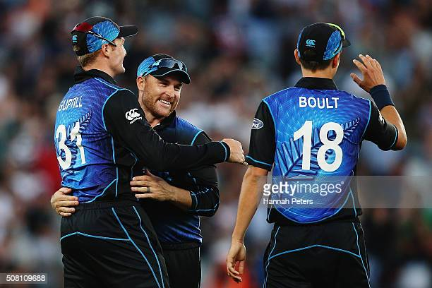 Martin Guptill of the Black Caps celebrates with Brendon McCullum and Trent Boult of the Black Caps after winning the One Day International match...
