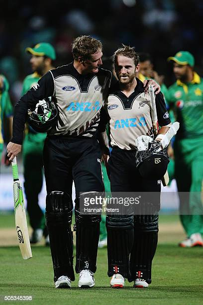 Martin Guptill of the Black Caps celebrates with Kane Williamson of the Black Caps after winning the International Twenty20 match between New Zealand...