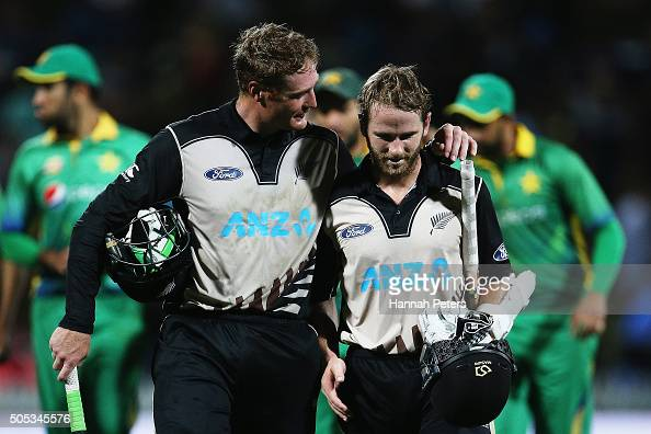 Martin Guptill of the Black Caps celebrates with Kane Williamson of the Black Caps after winning the International Twenty20 match between New Zealand...