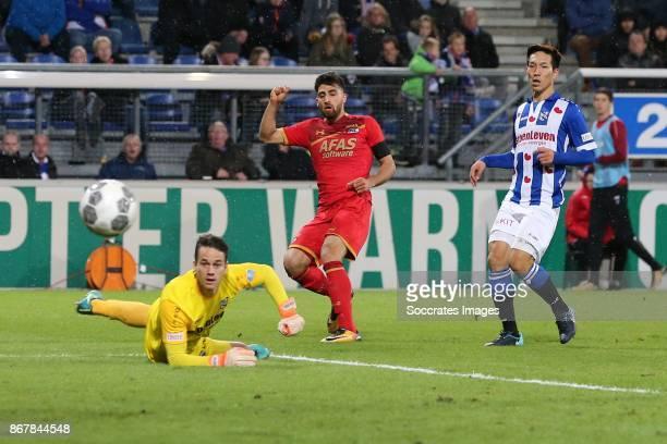 *Martin Hansen* of SC Heerenveen *Alireza Jahanbakhsh* of AZ Alkmaar *Yuki Kobayashi* of SC Heerenveen during the Dutch Eredivisie match between SC...