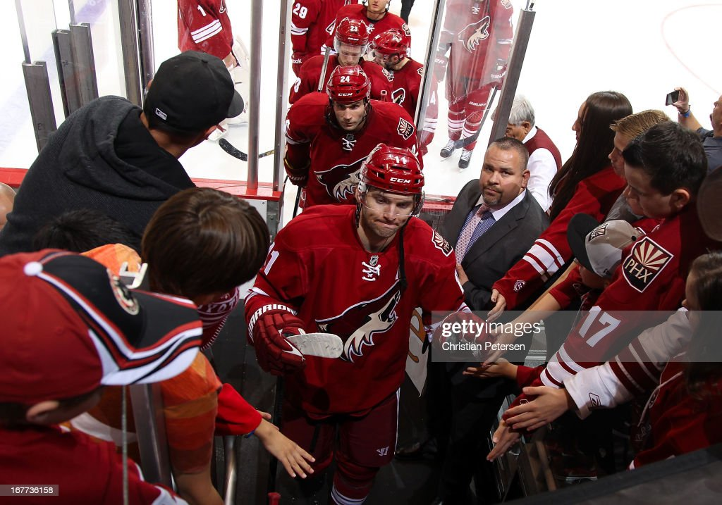 Martin Hanzal #11 and Kyle Chipchura #24 of the Phoenix Coyotes are greeted by fans as he skate off the ice following the NHL game against the Colorado Avalanche at Jobing.com Arena on April 26, 2013 in Glendale, Arizona. The Avalanche defeated the Coyotes 5-4 in an overtime shoot-out.