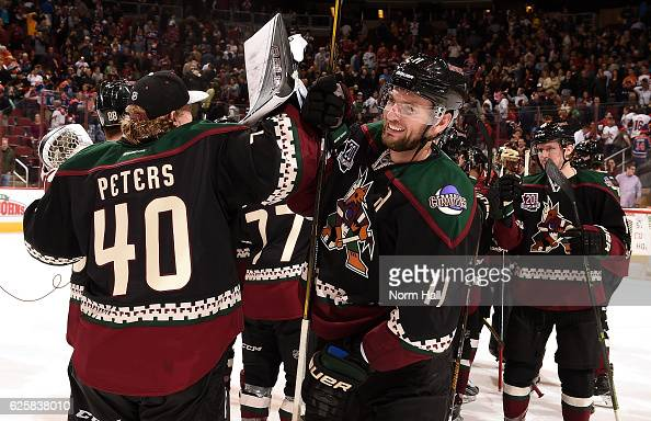 Martin Hanzal Justin Peters and teammates of the Arizona Coyotes celebrate a 32 shoot out win against the Edmonton Oilers at Gila River Arena on...