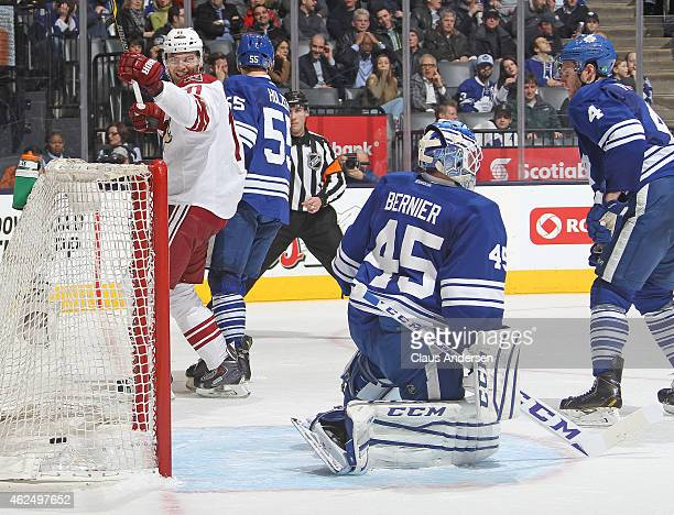 Martin Hanzal of the Arizona Coyotes celebrates a goal by teammate Sam Gagner against Jonathan Bernier of the Toronto Maple Leafs during an NHL game...