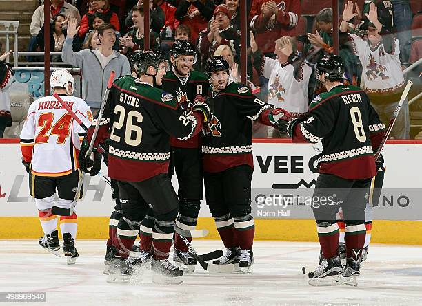 Martin Hanzal of the Arizona Coyotes celebrates with teammates Michael Stone Mikkel Boedker and Tobias Rieder after his second period goal against...