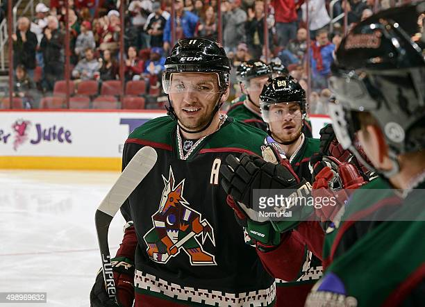 Martin Hanzal of the Arizona Coyotes is congratulated by teammates after his second period goal against the Calgary Flames at Gila River Arena on...