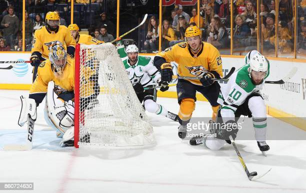 Martin Hanzal of the Dallas Stars battles for the puck against Alexei Emelin of the Nashville Predators as Pekka Rinne eyes the puck during an NHL...