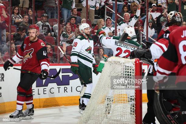 Martin Hanzal of the Minnesota Wild celebrates with Nino Niederreiter after Hanzal scored a power play goal against the Arizona Coyotes during the...