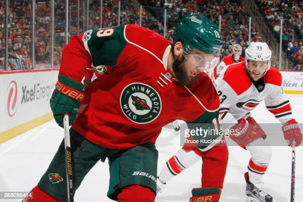 Martin Hanzal of the Minnesota Wild controls the puck with Derek Ryan of the Carolina Hurricanes defending during the game on April 4 2017 at the...