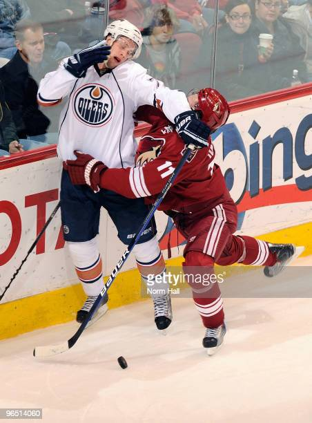 Martin Hanzal of the Phoenix Coyotes and Tom Gilbert of the Edmonton Oilers collide on February 8 2010 at Jobingcom Arena in Glendale Arizona