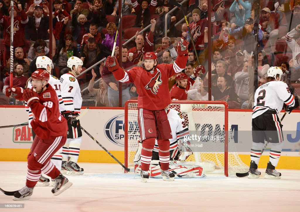 <a gi-track='captionPersonalityLinkClicked' href=/galleries/search?phrase=Martin+Hanzal&family=editorial&specificpeople=2109469 ng-click='$event.stopPropagation()'>Martin Hanzal</a> #11 of the Phoenix Coyotes celebrates in front of goalie <a gi-track='captionPersonalityLinkClicked' href=/galleries/search?phrase=Ray+Emery&family=editorial&specificpeople=218109 ng-click='$event.stopPropagation()'>Ray Emery</a> #30 and <a gi-track='captionPersonalityLinkClicked' href=/galleries/search?phrase=Brent+Seabrook&family=editorial&specificpeople=638862 ng-click='$event.stopPropagation()'>Brent Seabrook</a> #7 of the Chicago Blackhawks after his second period at Jobing.com Arena on February 7, 2013 in Glendale, Arizona.