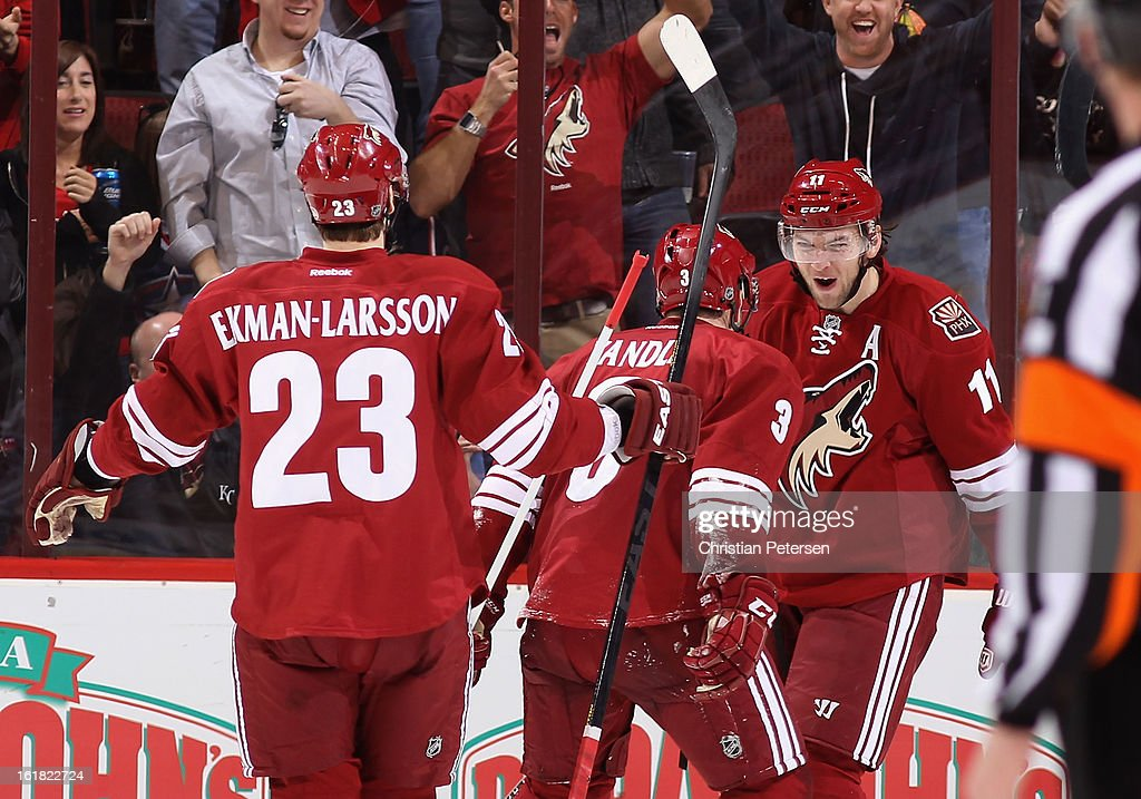<a gi-track='captionPersonalityLinkClicked' href=/galleries/search?phrase=Martin+Hanzal&family=editorial&specificpeople=2109469 ng-click='$event.stopPropagation()'>Martin Hanzal</a> #11 of the Phoenix Coyotes celebrates with <a gi-track='captionPersonalityLinkClicked' href=/galleries/search?phrase=Keith+Yandle&family=editorial&specificpeople=606912 ng-click='$event.stopPropagation()'>Keith Yandle</a> #3 and <a gi-track='captionPersonalityLinkClicked' href=/galleries/search?phrase=Oliver+Ekman-Larsson&family=editorial&specificpeople=5894618 ng-click='$event.stopPropagation()'>Oliver Ekman-Larsson</a> #23 after scoring a third period power play goal against the Columbus Blue Jackets during the NHL game at Jobing.com Arena on February 16, 2013 in Glendale, Arizona. The Coyotes defeated the Blue Jackets 5-3.