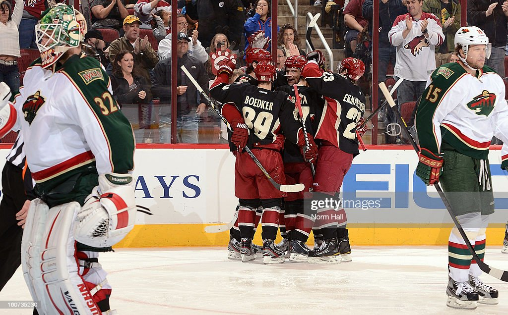 <a gi-track='captionPersonalityLinkClicked' href=/galleries/search?phrase=Martin+Hanzal&family=editorial&specificpeople=2109469 ng-click='$event.stopPropagation()'>Martin Hanzal</a> #11 of the Phoenix Coyotes celebrates with teammates after his second period goal against the Minnesota Wild at Jobing.com Arena on February 4, 2013 in Glendale, Arizona.