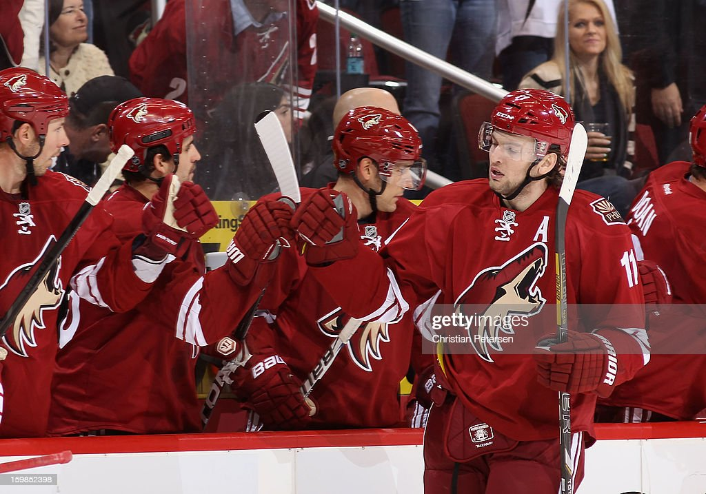 Martin Hanzal #11 of the Phoenix Coyotes celebrates with teammates on the bench after scoring against the Chicago Blackhawks during the NHL game at Jobing.com Arena on January 20, 2013 in Glendale, Arizona. The Blackhawks defeated the Coyotes 6-4.