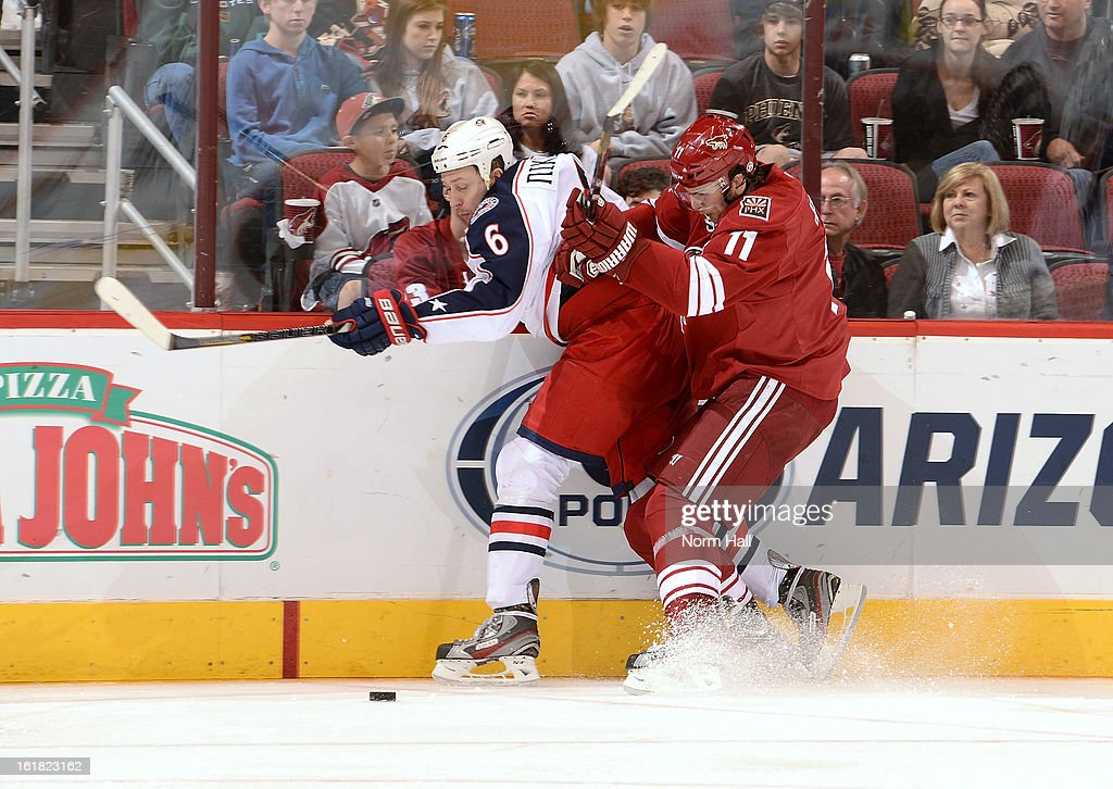 <a gi-track='captionPersonalityLinkClicked' href=/galleries/search?phrase=Martin+Hanzal&family=editorial&specificpeople=2109469 ng-click='$event.stopPropagation()'>Martin Hanzal</a> #11 of the Phoenix Coyotes checks <a gi-track='captionPersonalityLinkClicked' href=/galleries/search?phrase=Nikita+Nikitin&family=editorial&specificpeople=722107 ng-click='$event.stopPropagation()'>Nikita Nikitin</a> #6 of the Columbus Blue Jackets into the boards during the third period at Jobing.com Arena on February 16, 2013 in Glendale, Arizona.