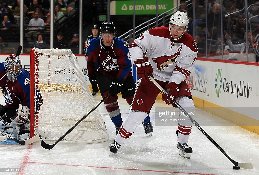 <a gi-track='captionPersonalityLinkClicked' href=/galleries/search?phrase=Martin+Hanzal&family=editorial&specificpeople=2109469 ng-click='$event.stopPropagation()'>Martin Hanzal</a> #11 of the Phoenix Coyotes controls the puck against <a gi-track='captionPersonalityLinkClicked' href=/galleries/search?phrase=Erik+Johnson+-+Ice+Hockey+Player&family=editorial&specificpeople=457696 ng-click='$event.stopPropagation()'>Erik Johnson</a> #6 of the Colorado Avalanche at the Pepsi Center on February 11, 2013 in Denver, Colorado. The Coyotes defeated the Avalanche 3-2 in overtime.