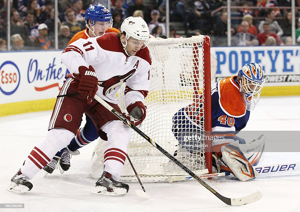 <a gi-track='captionPersonalityLinkClicked' href=/galleries/search?phrase=Martin+Hanzal&family=editorial&specificpeople=2109469 ng-click='$event.stopPropagation()'>Martin Hanzal</a> #11 of the Phoenix Coyotes drives around the net as Ryan Hugent-Hopkins #93 and <a gi-track='captionPersonalityLinkClicked' href=/galleries/search?phrase=Devan+Dubnyk&family=editorial&specificpeople=2089794 ng-click='$event.stopPropagation()'>Devan Dubnyk</a> #40 of the Edmonton Oilers try to defend him at Rexall Place on April 10, 2013 in Edmonton, Canada.