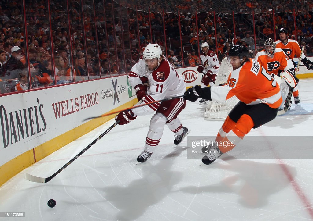 <a gi-track='captionPersonalityLinkClicked' href=/galleries/search?phrase=Martin+Hanzal&family=editorial&specificpeople=2109469 ng-click='$event.stopPropagation()'>Martin Hanzal</a> #11 of the Phoenix Coyotes is checked by <a gi-track='captionPersonalityLinkClicked' href=/galleries/search?phrase=Braydon+Coburn&family=editorial&specificpeople=2077063 ng-click='$event.stopPropagation()'>Braydon Coburn</a> #5 of the Philadelphia Flyers at the Wells Fargo Center on October 11, 2013 in Philadelphia, Pennsylvania. The Coyotes defeated the Flyers 2-1.