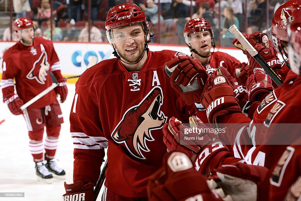 <a gi-track='captionPersonalityLinkClicked' href=/galleries/search?phrase=Martin+Hanzal&family=editorial&specificpeople=2109469 ng-click='$event.stopPropagation()'>Martin Hanzal</a> #11 of the Phoenix Coyotes is congratulated by teammates on the bench after his second period goal against the Colorado Avalanche at Jobing.com Arena on April 6, 2013 in Glendale, Arizona.