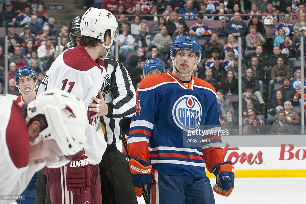 <a gi-track='captionPersonalityLinkClicked' href=/galleries/search?phrase=Martin+Hanzal&family=editorial&specificpeople=2109469 ng-click='$event.stopPropagation()'>Martin Hanzal</a> #11 of the Phoenix Coyotes is separated from <a gi-track='captionPersonalityLinkClicked' href=/galleries/search?phrase=Taylor+Hall&family=editorial&specificpeople=2808377 ng-click='$event.stopPropagation()'>Taylor Hall</a> #4 of the Edmonton Oilers after a scrum on April 10, 2013 at Rexall Place in Edmonton, Alberta, Canada.