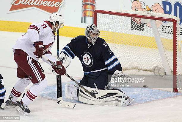 Martin Hanzal of the Phoenix Coyotes scores on Ondrej Pavelec of the Winnipeg Jets in thirdperiod action in an NHL game at the MTS Centre on February...