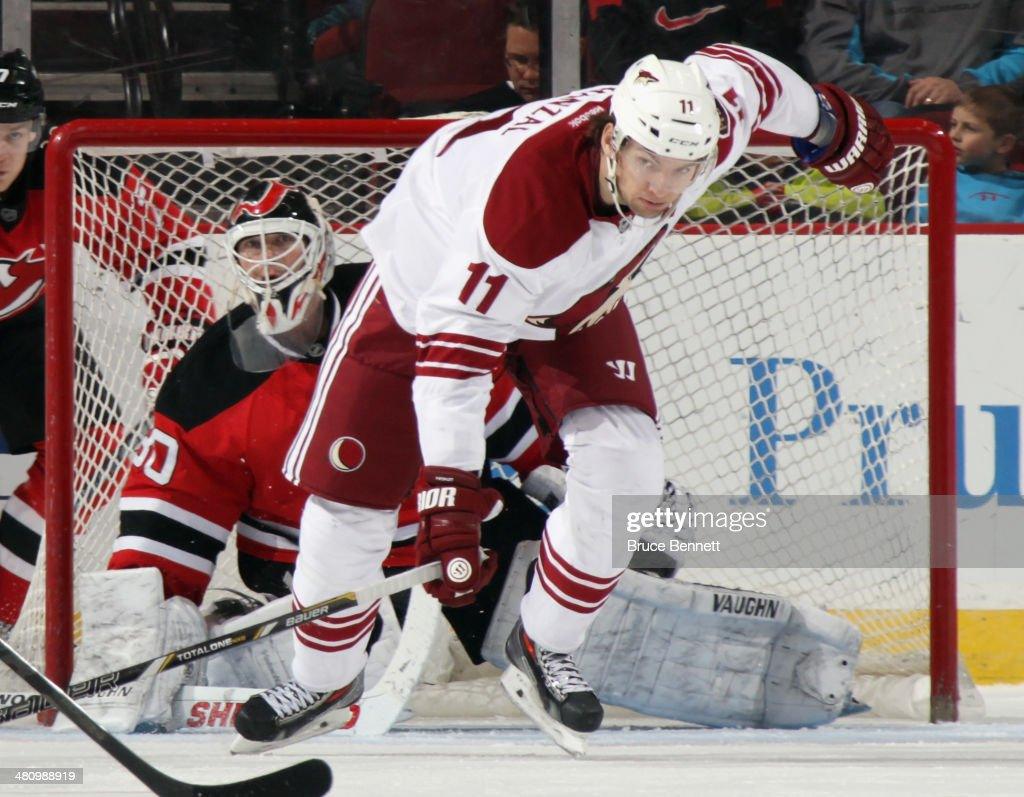 <a gi-track='captionPersonalityLinkClicked' href=/galleries/search?phrase=Martin+Hanzal&family=editorial&specificpeople=2109469 ng-click='$event.stopPropagation()'>Martin Hanzal</a> #11 of the Phoenix Coyotes skates against the New Jersey Devils at the Prudential Center on March 27, 2014 in Newark, New Jersey. The Coyotes defeated the Devils 3-2 in the shootout.