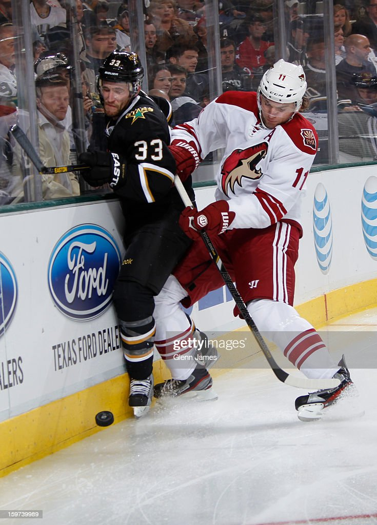 <a gi-track='captionPersonalityLinkClicked' href=/galleries/search?phrase=Martin+Hanzal&family=editorial&specificpeople=2109469 ng-click='$event.stopPropagation()'>Martin Hanzal</a> #11 of the Phoenix Coyotes tries to keep the puck away against <a gi-track='captionPersonalityLinkClicked' href=/galleries/search?phrase=Alex+Goligoski&family=editorial&specificpeople=791866 ng-click='$event.stopPropagation()'>Alex Goligoski</a> #33 of the Dallas Stars at the American Airlines Center on January 19, 2013 in Dallas, Texas.