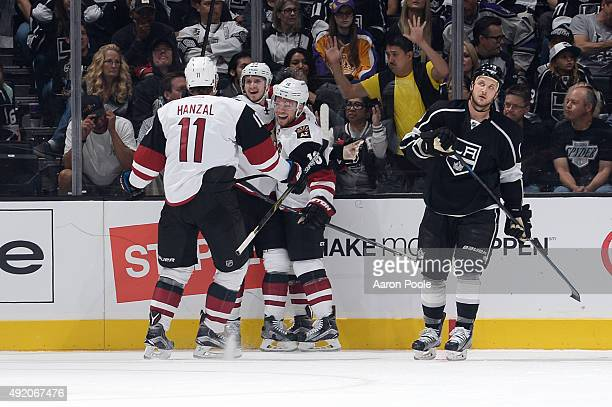 Martin Hanzal Oliver EkmanLarsson and Max Domi of the Arizona Coyotes celebrate in the first period during a game against the Los Angeles Kings at...