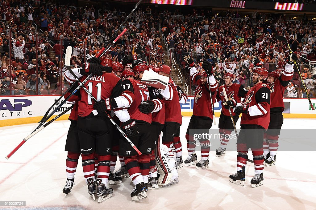 Martin Hanzal #11, Radim Vrbata #11 and the rest of the Arizona Coyotes players celebrate a 4-3 overtime victory against the Philadelphia Flyers at Gila River Arena on October 15, 2016 in Glendale, Arizona.