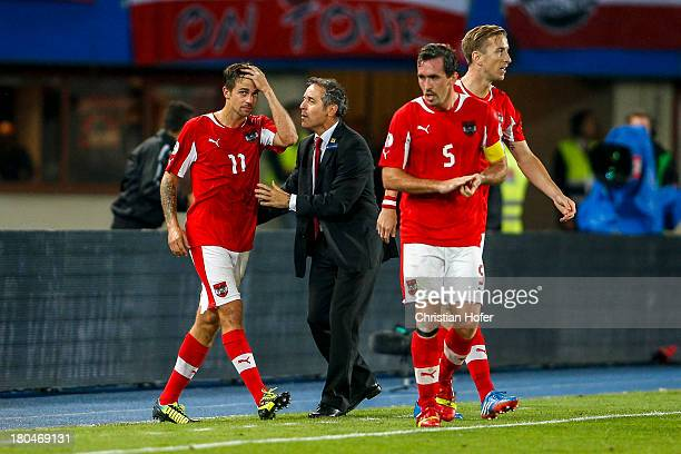 Martin Harnik Coach Marcel Koller Christian Fuchs and Marc Janko of Austria celebrate after scoring during the FIFA World Cup 2014 Group C...