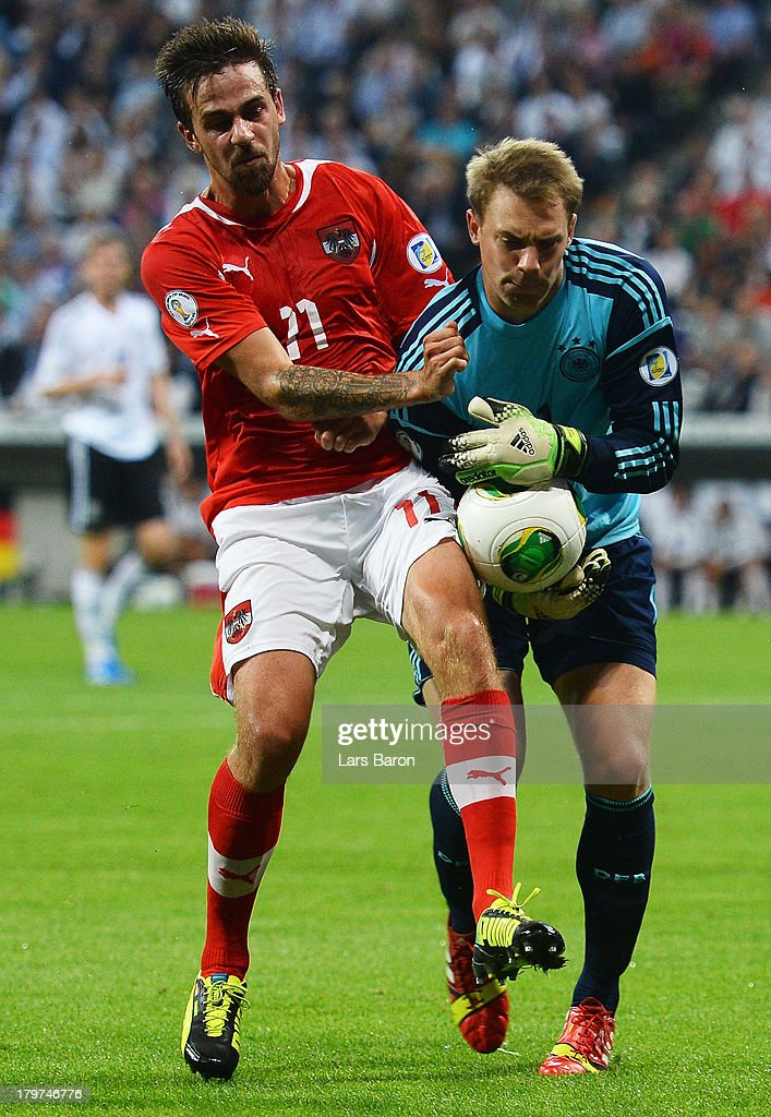Martin Harnik of Austria challenges goalkeeper Manuel Neuer of Germany during the FIFA 2014 World Cup Qualifying Group C match between Germany and Austria Allianz Arena on September 6, 2013 in Munich, Germany.