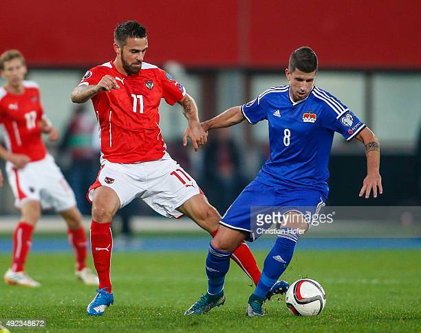 Martin Harnik of Austria competes for the ball with Sandro Wieser of Liechtenstein during the UEFA EURO 2016 Qualifier between Austria and...