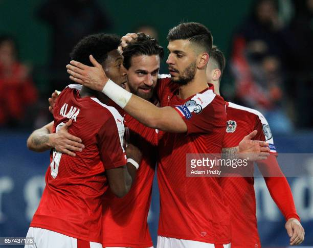 Martin Harnik of Austria is congratulated by David Alaba and Aleksandar Dragovic after scoring the second goal during the Austria v Moldavia 2018...