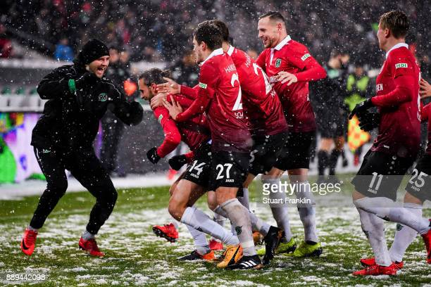 Martin Harnik of Hannover 96 celebrates with his teammates after scoring his team's second goal to make it 20 during the Bundesliga match between...