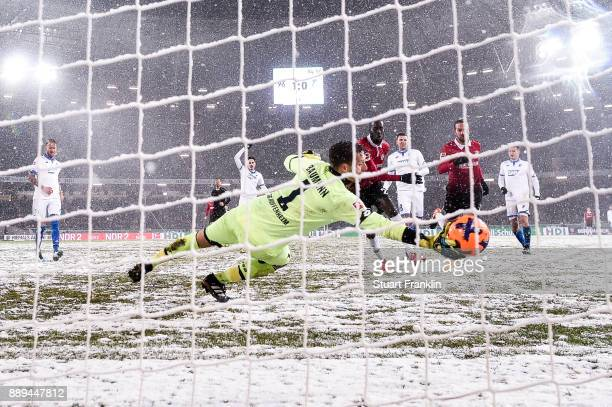 Martin Harnik of Hannover 96 scores with team's second goal against Oliver Baumann of 1899 Hoffenheim to make it 20 during the Bundesliga match...