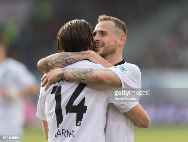 Martin Harnik of Hannover celebrates his team's first goal with team mate Marvin Bakalorz of Hannover during the Second Bundesliga match between 1 FC...