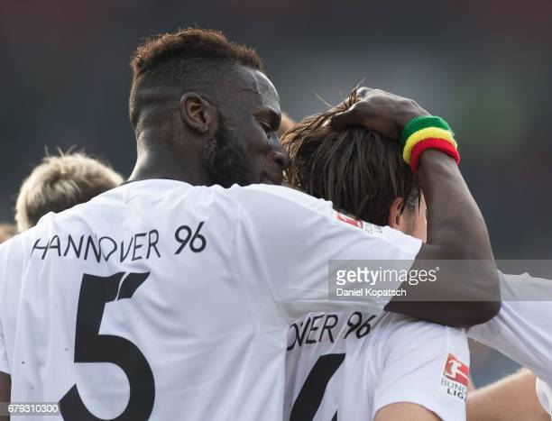 Martin Harnik of Hannover celebrates his team's first goal with team mate Salif Sane of Hannover during the Second Bundesliga match between 1 FC...
