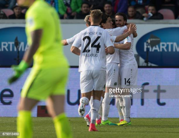 Martin Harnik of Hannover celebrates his team's second goal with team mates during the Second Bundesliga match between 1 FC Heidenheim 1846 and...
