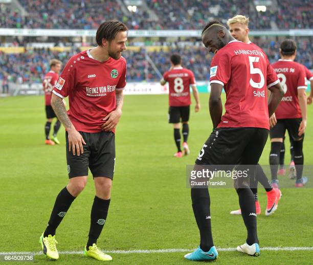 Martin Harnik of Hannover celebrates scoring his goal with Salif Sane during the Second Bundesliga match between Hannover 96 and 1 FC Nuernberg at...