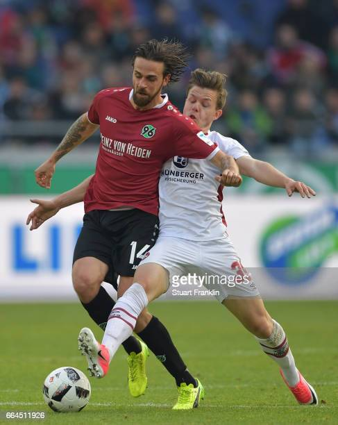 Martin Harnik of Hannover is challenged by Patrick Kammerbauer of Nuernberg during the Second Bundesliga match between Hannover 96 and 1 FC Nuernberg...