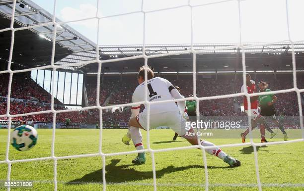 Martin Harnik of Hannover scores his team's first goal past goalkeeper Rene Adler of Mainz during the Bundesliga match between 1 FSV Mainz 05 and...