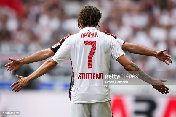Martin Harnik of Stuttgart argues with Rafael van der Vaart of Hamburg during the Bundesliga match between VfB Stuttgart and Hamburger SV at...