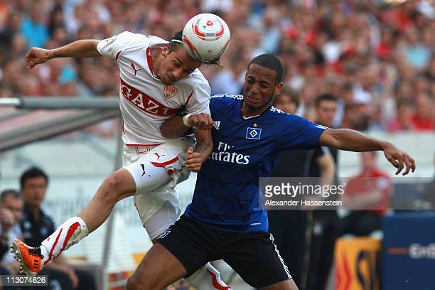Martin Harnik of Stuttgart battles for the ball with Dennis Aogo of Hamburg during the Bundesliga match between VfB Stuttgart and Hamburger SV at...