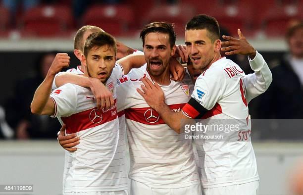 Martin Harnik of Stuttgart celebrates his team's first goal with team mates Moritz Leitner of Stuttgart and Vedad Ibisevic of Stuttgart during the...