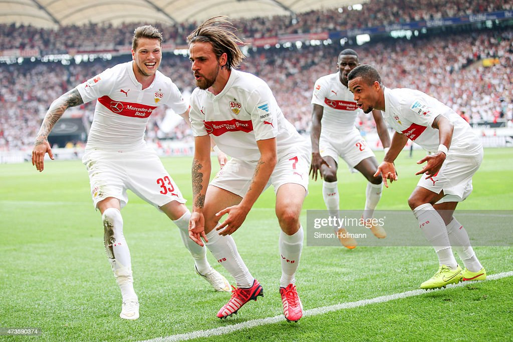 Martin Harnik of Stuttgart celebrates his team's second goal with his team mates Daniel Ginczek and Daniel Didavi during the Bundesliga match between...