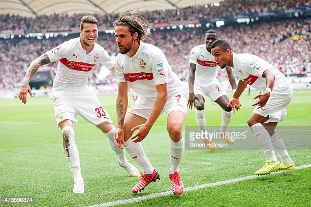 Martin Harnik of Stuttgart celebrates his team's second goal with his team mates Daniel Ginczek and Daniel Didavi during the Bundesliga match between...