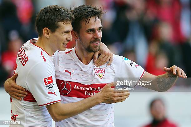 Martin Harnik of Stuttgart celebrates his team's second goal with team mate Daniel Schwaab during the Bundesliga match between VfB Stuttgart and...