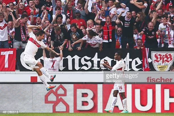 Martin Harnik of Stuttgart celebrates his team's second goal with team mate Ibrahima Traore during the Bundesliga match between VfB Stuttgart and...