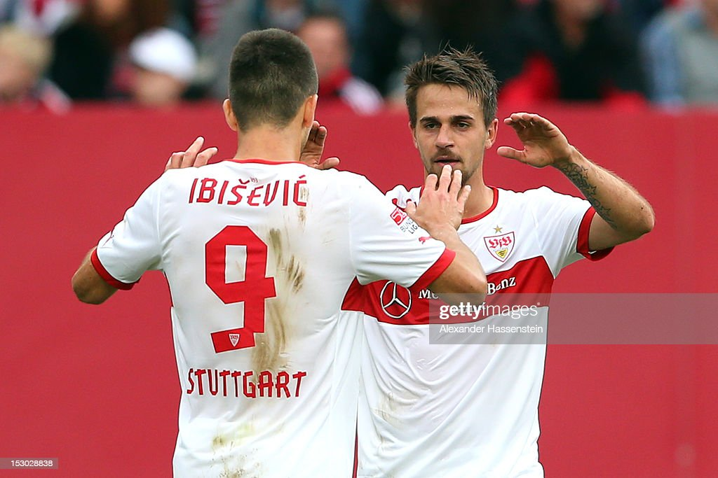 <a gi-track='captionPersonalityLinkClicked' href=/galleries/search?phrase=Martin+Harnik&family=editorial&specificpeople=733193 ng-click='$event.stopPropagation()'>Martin Harnik</a> (R) of Stuttgart celebrates scoring the second team goal with his team mate <a gi-track='captionPersonalityLinkClicked' href=/galleries/search?phrase=Vedad+Ibisevic&family=editorial&specificpeople=535857 ng-click='$event.stopPropagation()'>Vedad Ibisevic</a>, who scores the first goal, during the Bundesliga match between 1. FC Nuernberg and VfB Stuttgart at Easy Credit Stadium on September 29, 2012 in Nuremberg, Germany.