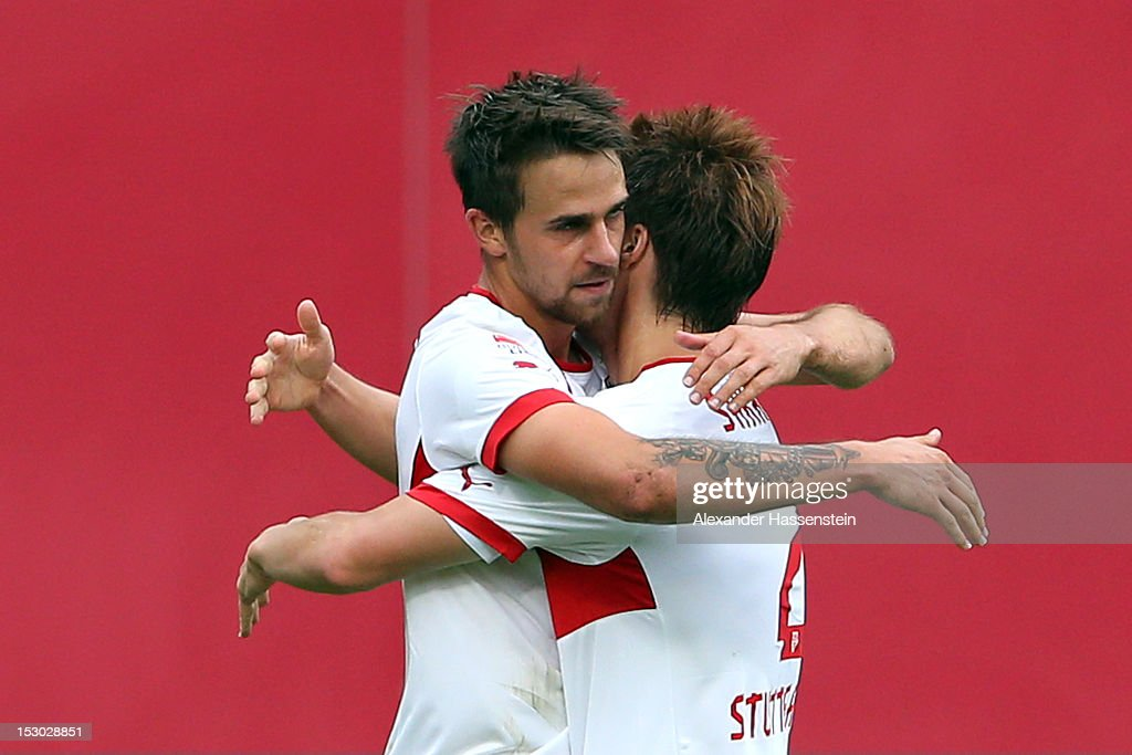 <a gi-track='captionPersonalityLinkClicked' href=/galleries/search?phrase=Martin+Harnik&family=editorial&specificpeople=733193 ng-click='$event.stopPropagation()'>Martin Harnik</a> (L) of Stuttgart celebrates scoring the second team goal with his team mate <a gi-track='captionPersonalityLinkClicked' href=/galleries/search?phrase=Gotoku+Sakai&family=editorial&specificpeople=7015160 ng-click='$event.stopPropagation()'>Gotoku Sakai</a> during the Bundesliga match between 1. FC Nuernberg and VfB Stuttgart at Easy Credit Stadium on September 29, 2012 in Nuremberg, Germany.