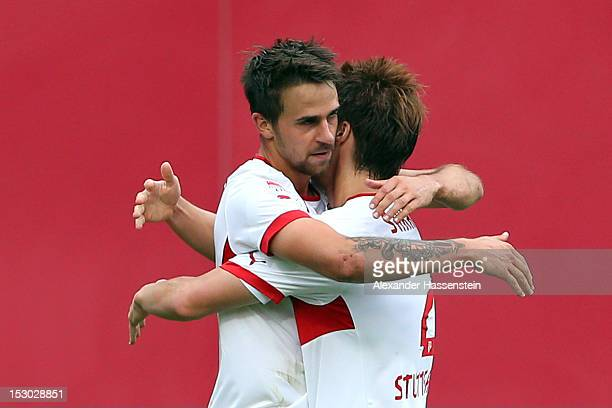 Martin Harnik of Stuttgart celebrates scoring the second team goal with his team mate Gotoku Sakai during the Bundesliga match between 1 FC Nuernberg...